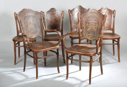 Quatre chaises à bandeau en hêtre et merisier...