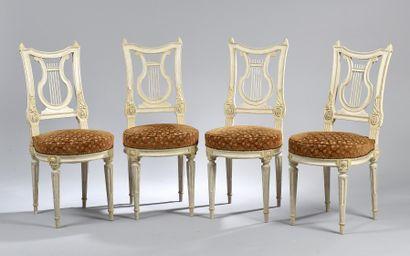 *Suite de quatre chaises en hêtre laqué,...