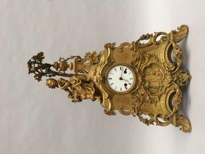 Pendule en bronze ciselé doré ornée d'une...