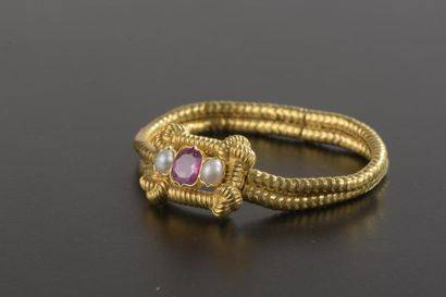 Bracelet en or jaune 18k à deux brins maille...