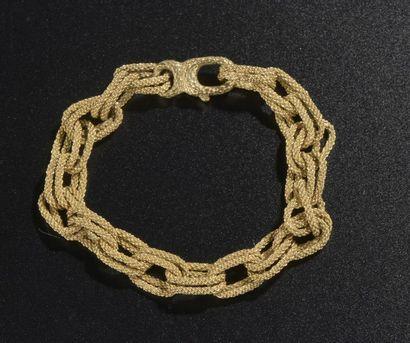 Bracelet en or jaune 18k à maille forçat...