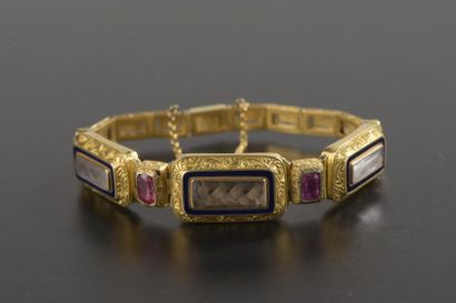 Petit bracelet en or jaune 18k à quinze maillons...