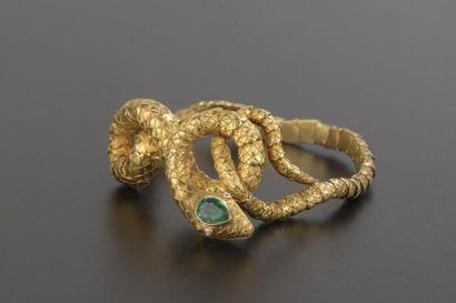 Bracelet souple en or jaune 18k gravé figurant...