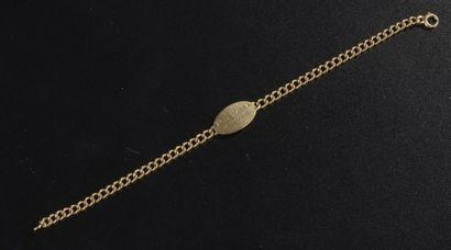 Bracelet gourmette en or jaune 18k, la plaque...