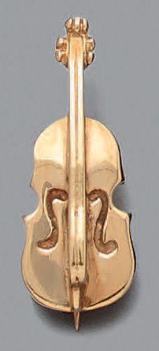 BROCHE «violon» en or jaune (750‰). Long....