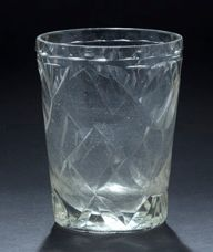 Faceted glass goblet, star-shaped base. 19th...