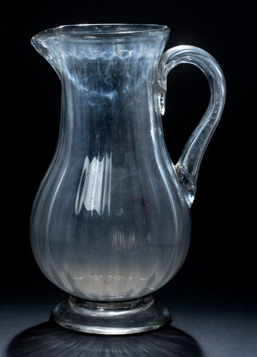 Large glass pitcher of baluster shape with...