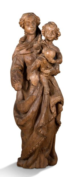 VIRGIN WITH CHILD in carved oak. 17th century...
