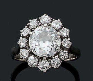 BAGUE «MARGUERITE» Diamant rond taille ancienne,...