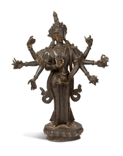 TIBET XXe SIECLE Sujet en bronze de patine brune représentant Avalokiteshvara à huit...