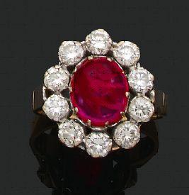 BAGUE «RUBIS» Rubis cabochon, diamants ronds...