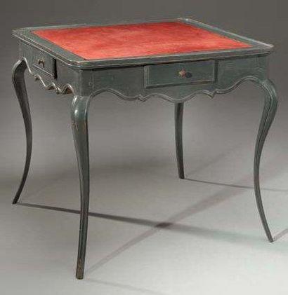 Table à jeux en bois relaqué gris. La ceinture...