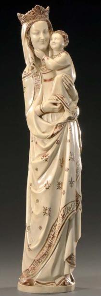 Vierge à l'Enfant en ivoire sculpté. Travail...