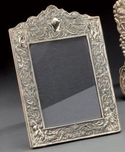 Cadre photo à monture en argent à décor de...