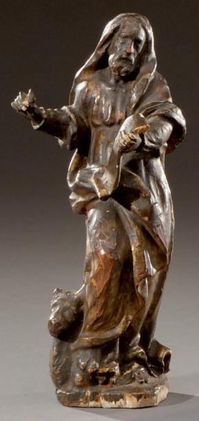 Sujet en bois sculpté représentant Saint-Luc...