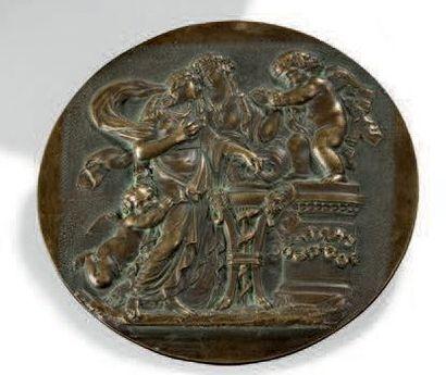 Médaille en bronze figurant une scène animée...