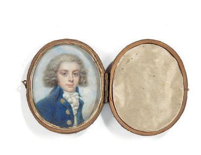 Ecole ANGLAISE vers 1780 Portrait d'un jeune homme à la redingote bleue sur fond...