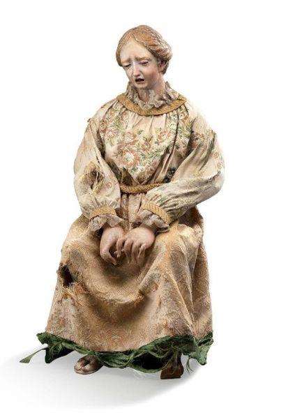 Statuette en bois sculpté et peint au naturel...