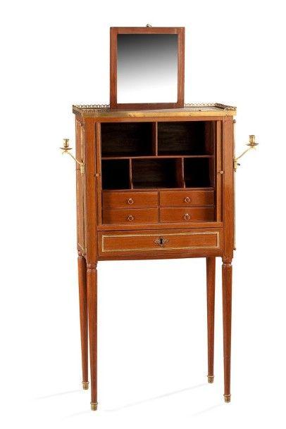 Amusant meuble formant coiffeuse en placage de bois. Il ouvre à un tiroir en ceinture...