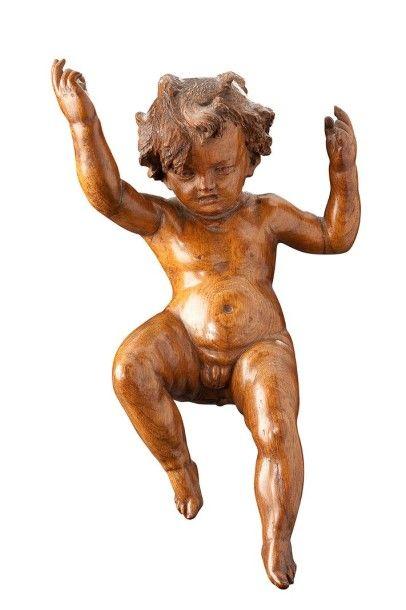 Sujet en noyer sculpté représentant un putto...