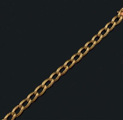Bracelet articulé en or jaune 18k tressé....