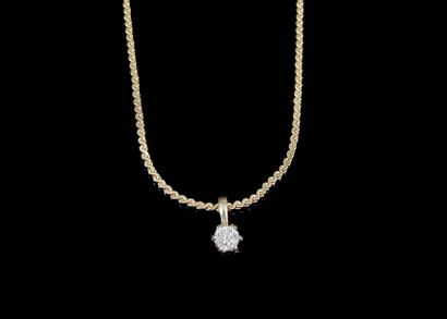 Pendentif solitaire serti d'un diamant et...