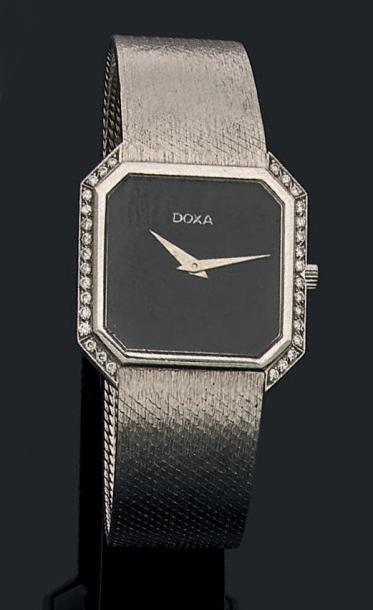 DOXA Montre de dame en or gris 18k (750) composée d'un cadran en onyx de forme carrée...