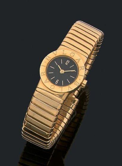 BULGARI Montre de dame en or jaune 18k (750), cadran rond fond gris, bracelet tubogaz....