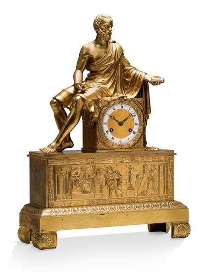 PENDULE BORNE en bronze ciselé et doré représentant Virgile assis tenant des parchemins....