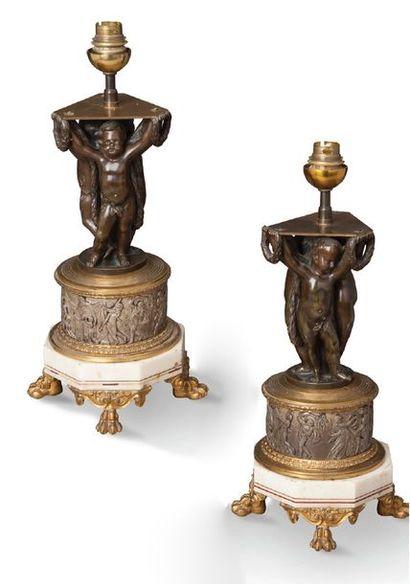PAIRE DE LAMPES en bronze à deux patines,...