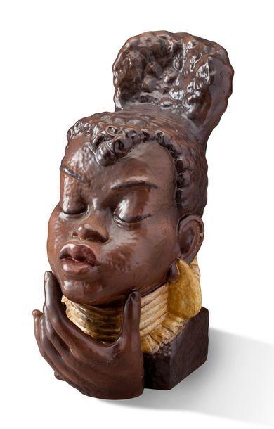 BUSTE en céramique figurant une africaine...