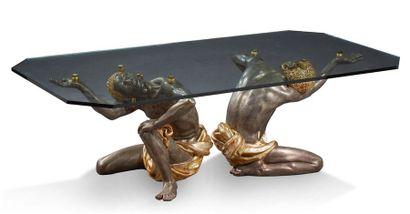 TABLE BASSE formée de deux esclaves agenouillés...