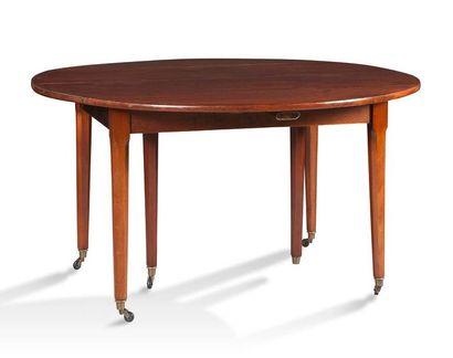 TABLE À VOLETS DE FORME OVALE en acajou reposant...