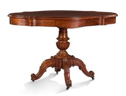 TABLE GUERIDON en placage d'acajou mouluré,...