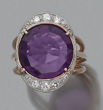 Bague Améthyste et diamants, or 18k (750)....
