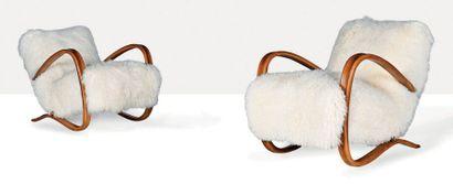 JINDRICH HALABALA (1903-1978) Paire de fauteuils dits H269 Peau, hêtre 75 x 70 x...