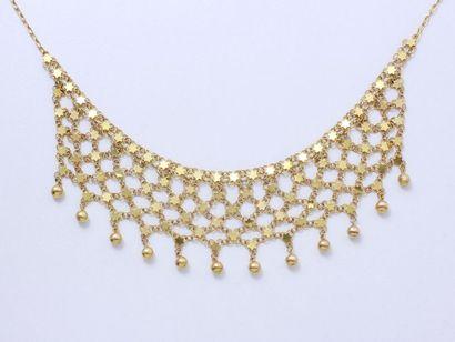 Collier draperie en or 585 millièmes, à décor...