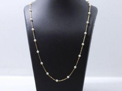Long collier composé d'une chaîne en or 750...