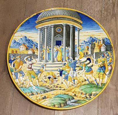 Assiette plate à décor italien.