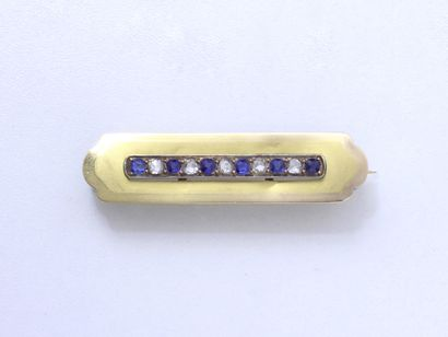 Broche en or 750 millièmes, à décor de cartouche...