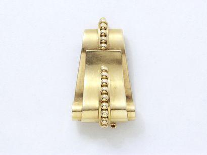 Broche clip en or 750 millièmes, à décor...