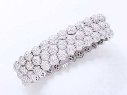 PIAGET  Bracelet souple en or gris 750 millièmes, composé de maillons imbriqués...