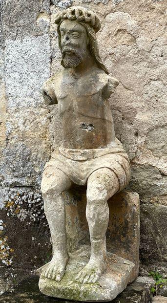 Christ assis.  Scuplture en pierre à l'image...