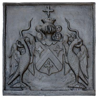 Plaque de cheminée Louis XIV.  Aux armes...