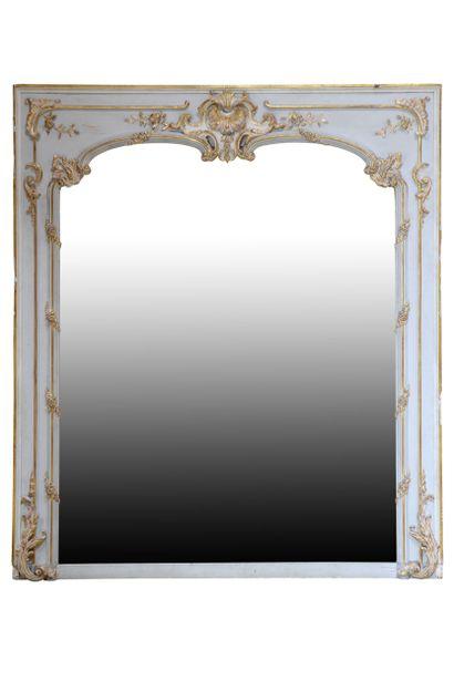 Miroir style Louis 15  Cadre orné de rocaille...