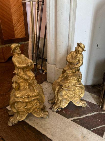 Paire de chenets en bronze ciselé et doré,...