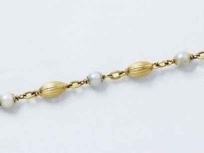 Bracelet en or 750 millièmes composé de motifs...