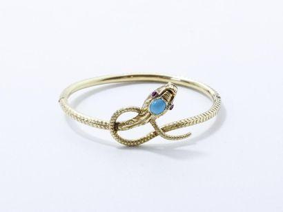 Bracelet en or 750 millièmes ciselé stylisant...