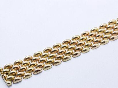 Bracelet ruban 2 tons d'or 750 millièmes,...
