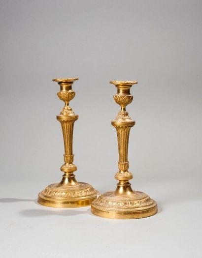 Paire de flambeaux en bronze doré  Style...
